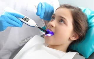 Child in the dental chair dental treatment during surgery.