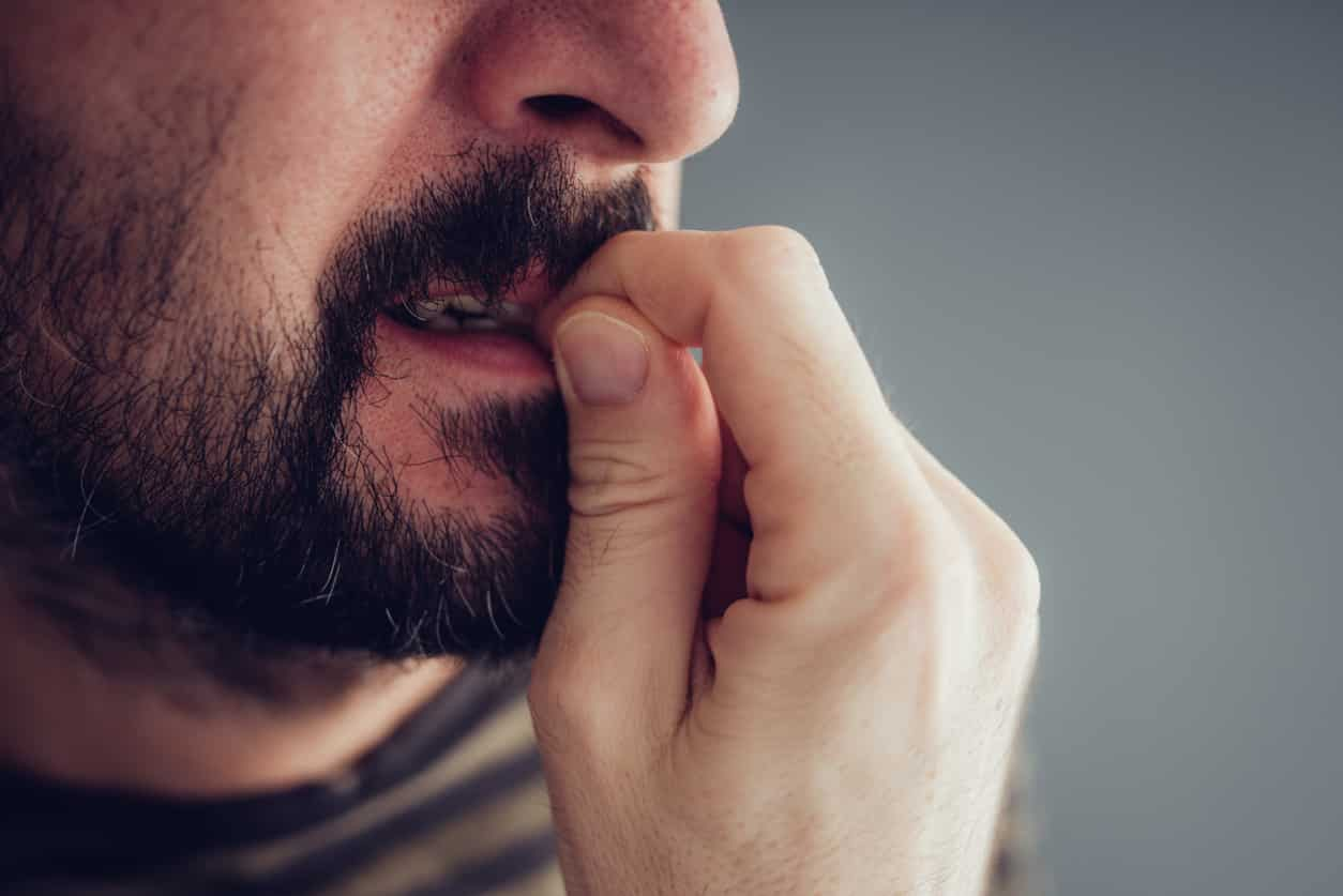 man biting his nails
