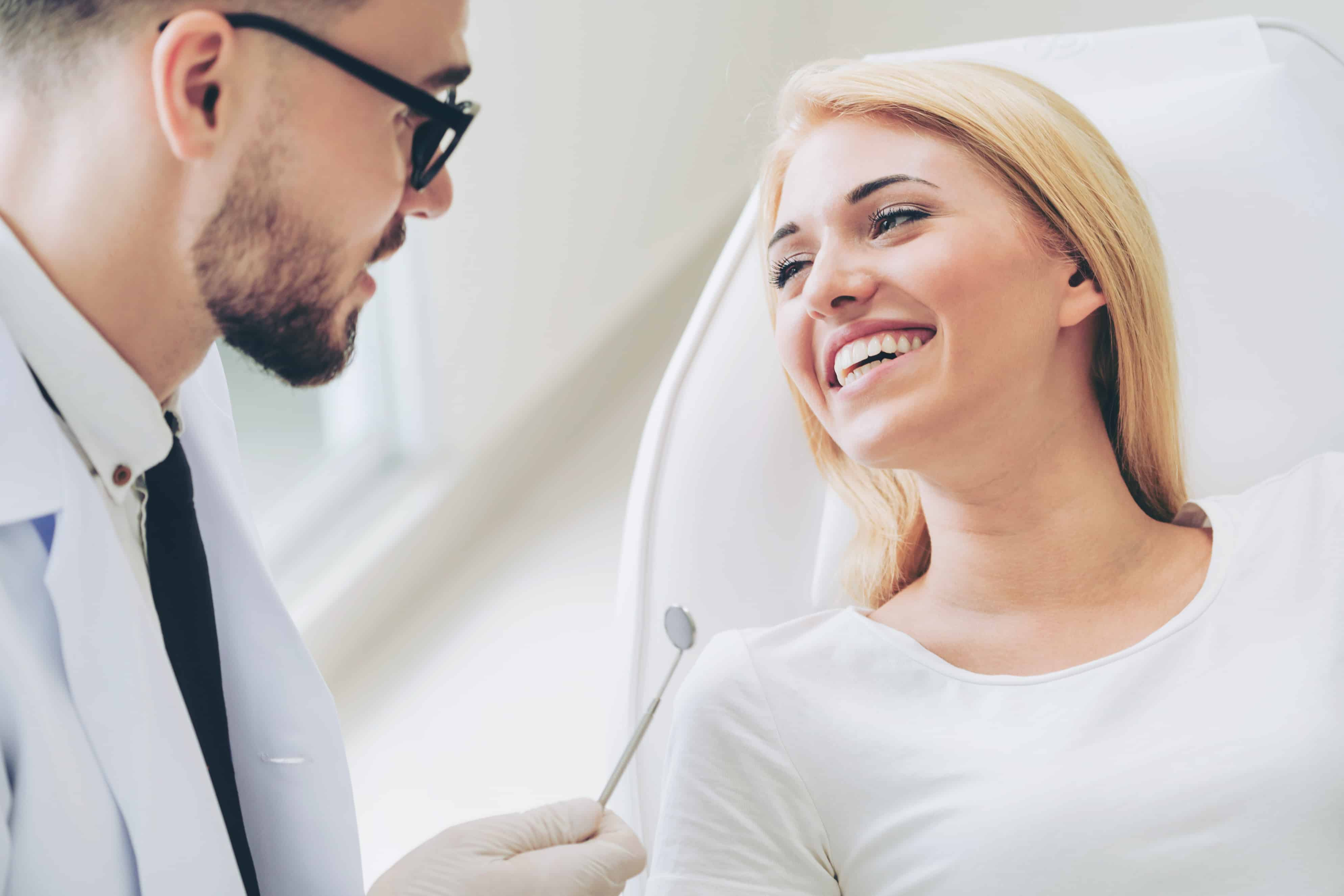 woman sitting in dentist chair smiling