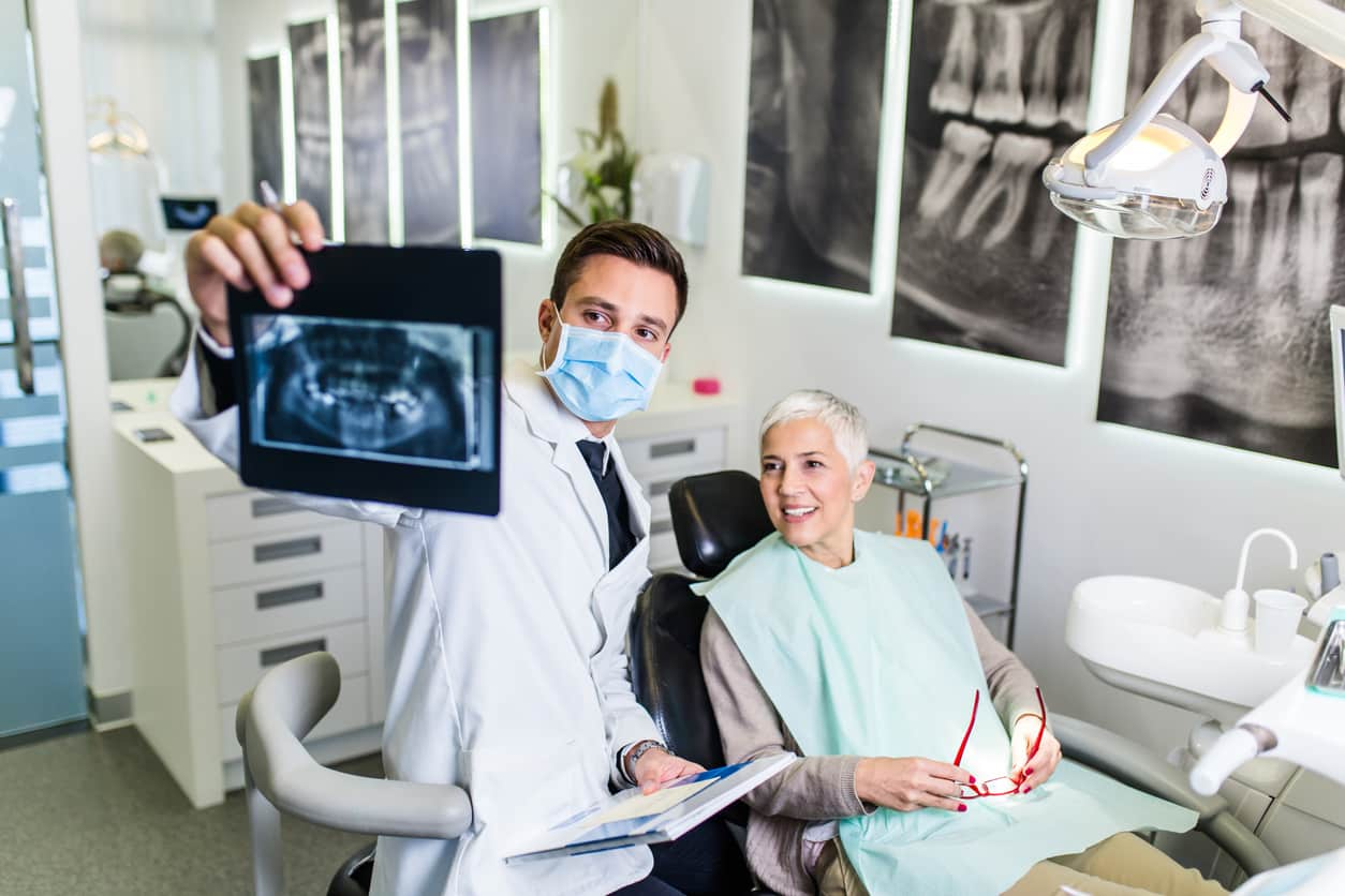 dentist showing woman dental xrays
