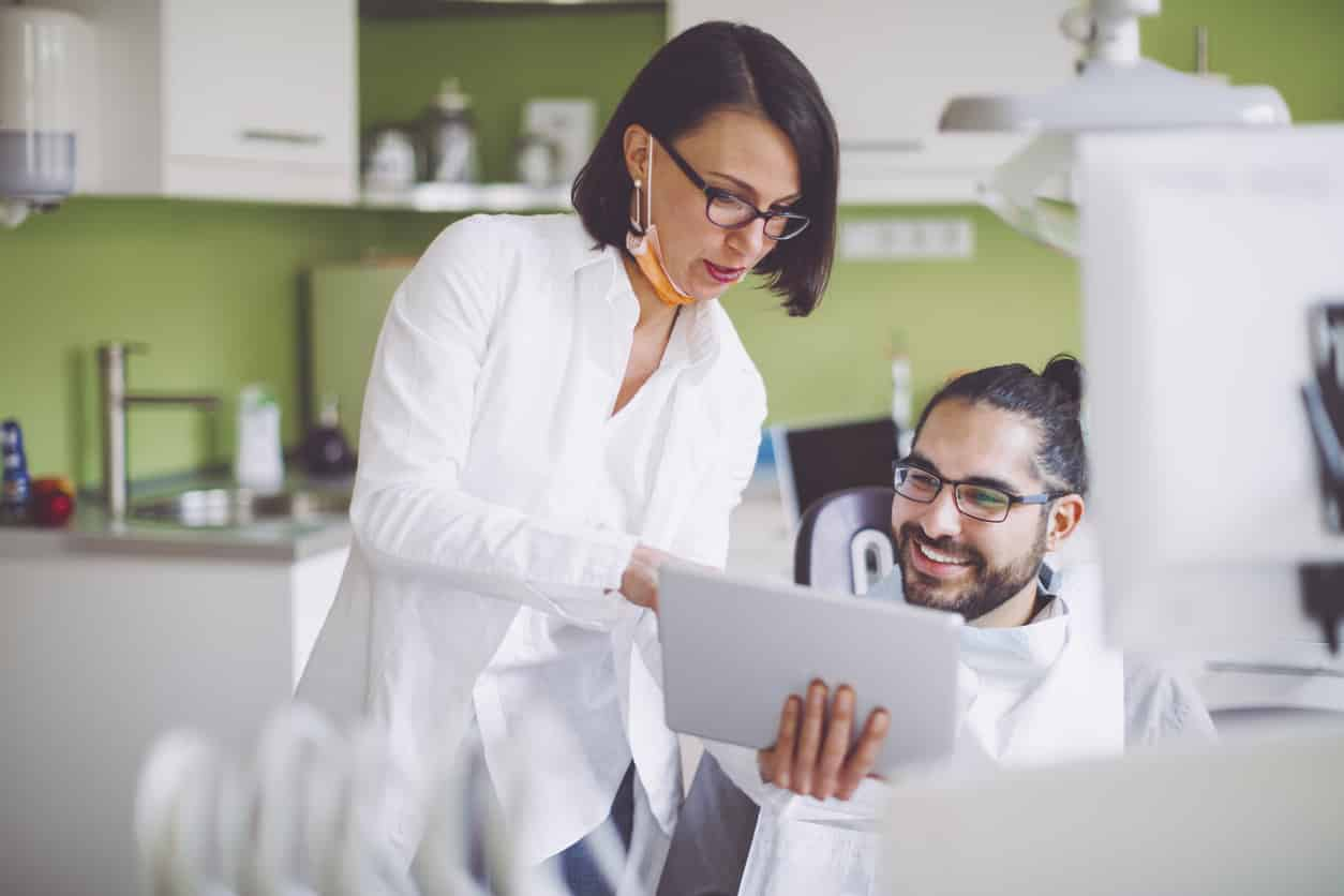 dentist discussing dental bonding with patient