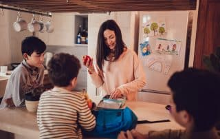 mother preparing healthy snacks for kids