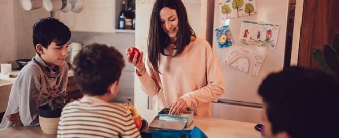 mother preparing healthy snacks for kids