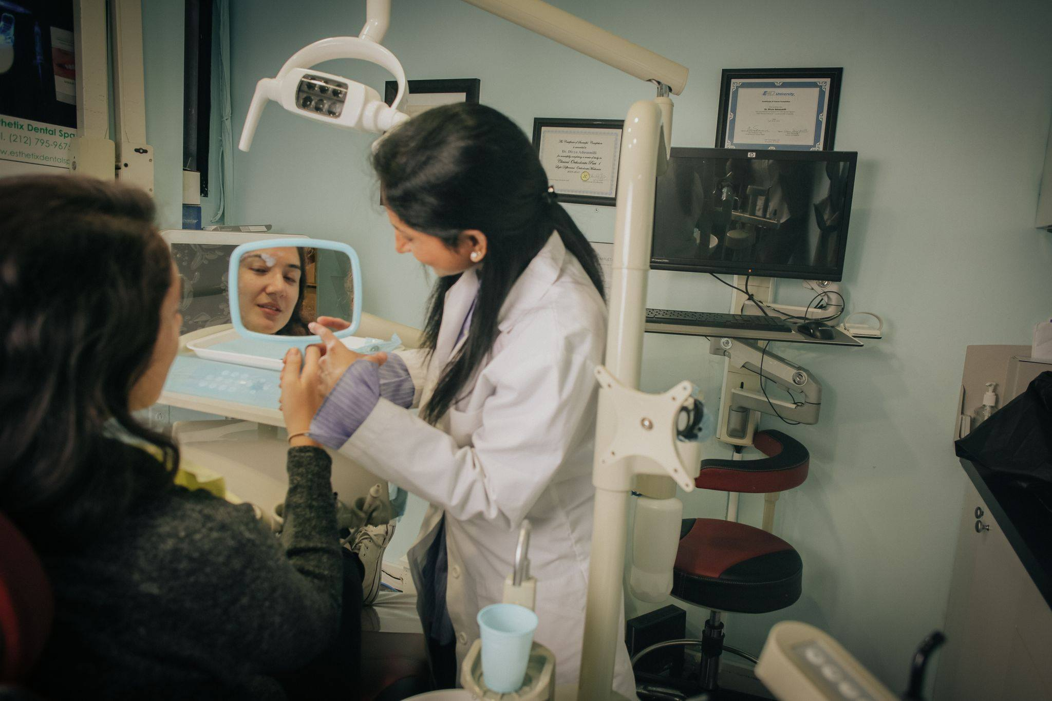 Dr. Divya Adusumilli with a patient