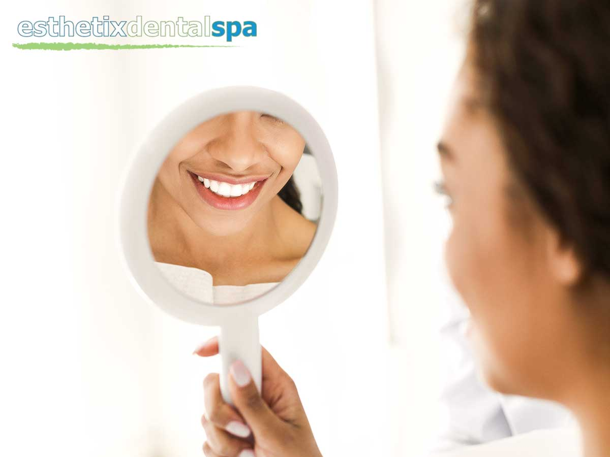 Woman With a Beautiful White Smile After A Dental Veneer Treatment In New York