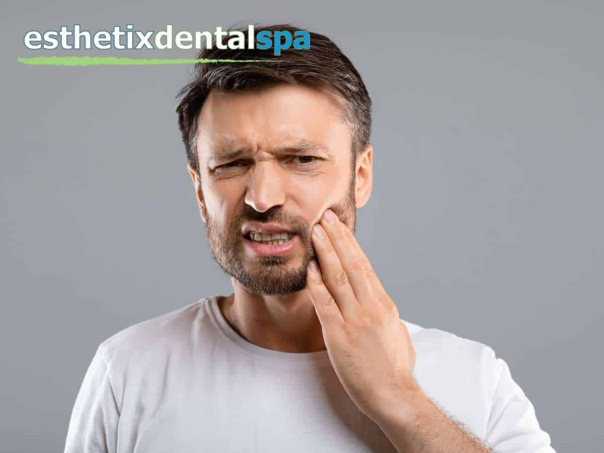A man with toothache due to a missing tooth in Washington Heights, NY.